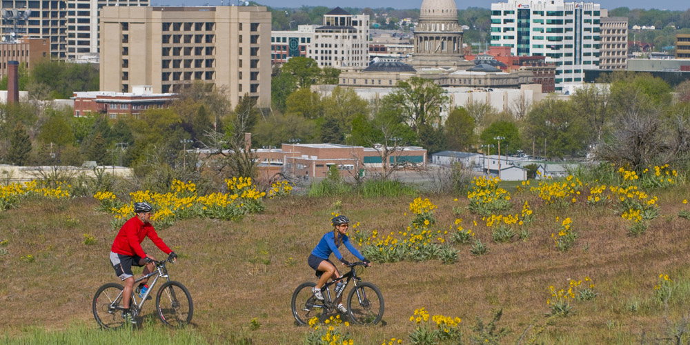 Mountain bikers enjoy the Boise Foothills, protected from development thanks to a 2001 vote by the city's residents.
