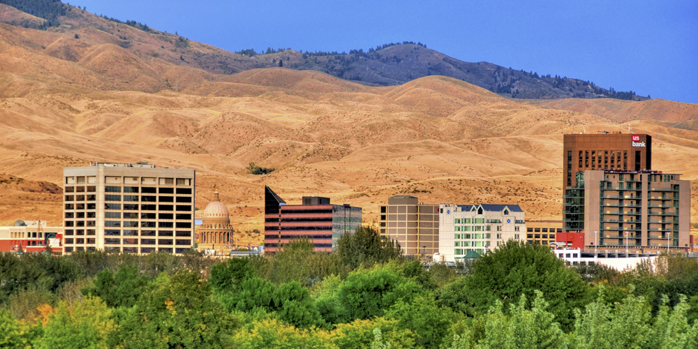 "Known as the ""City of Trees,"" Boise lies in a lush river environment surrounded by thousands of acres of foothills and open space."
