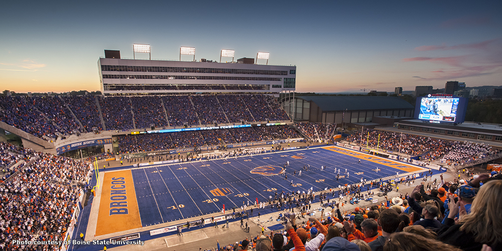 "Broncos fans by the thousands gather at Boise State University's famous home field, ""The Blue."""
